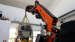 Articulated crane on tracks can access confined areas